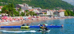 83644380 - petrovac, montenegro - september 19, 2015: unknown people rest on beach of popular resort town of petrovac, montenegro