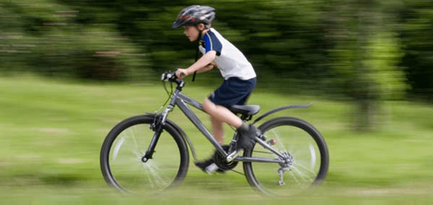 kid-on-bike.png